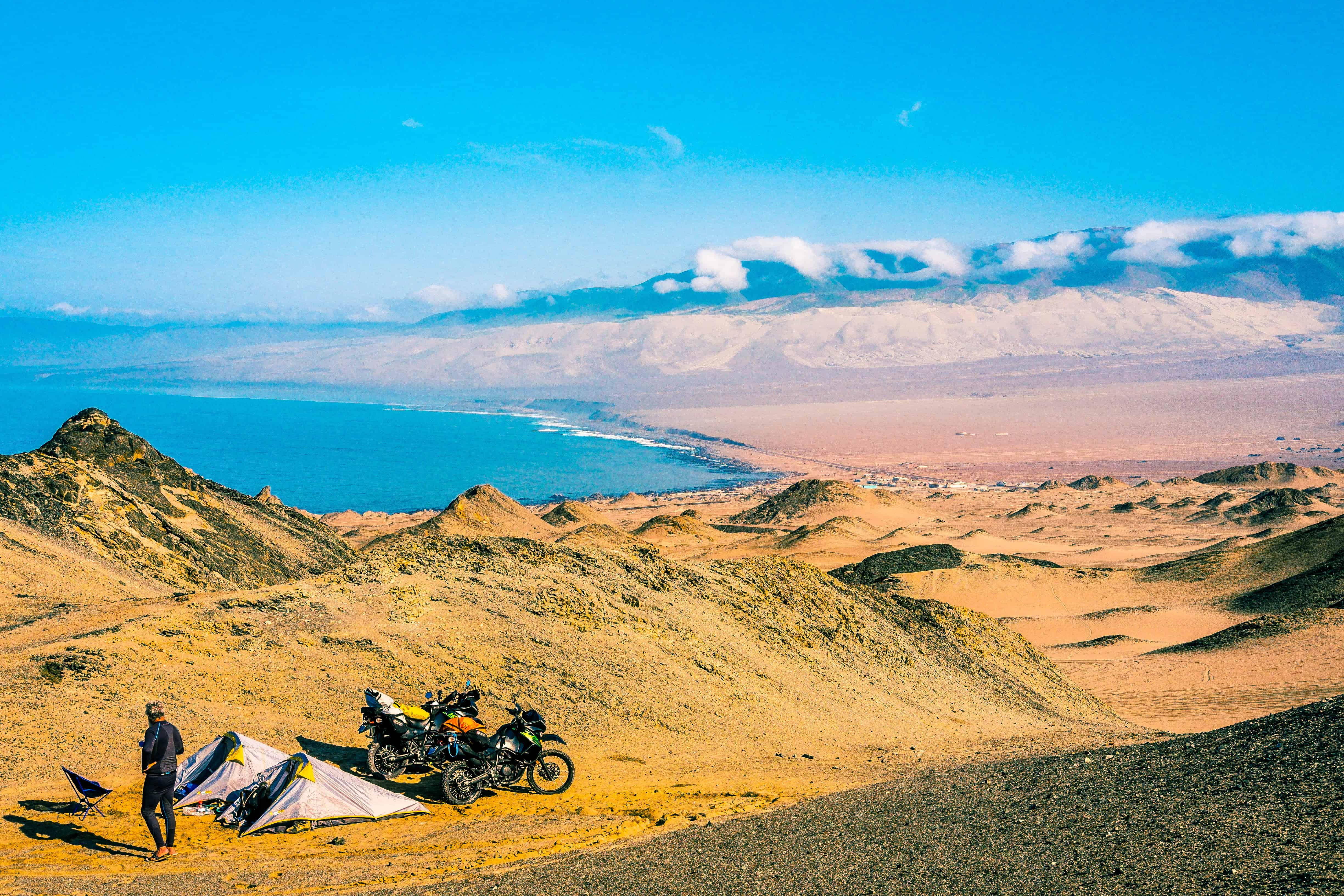 riding motorcycles along the pan americana to get to the 2019 dakar rally in Peru
