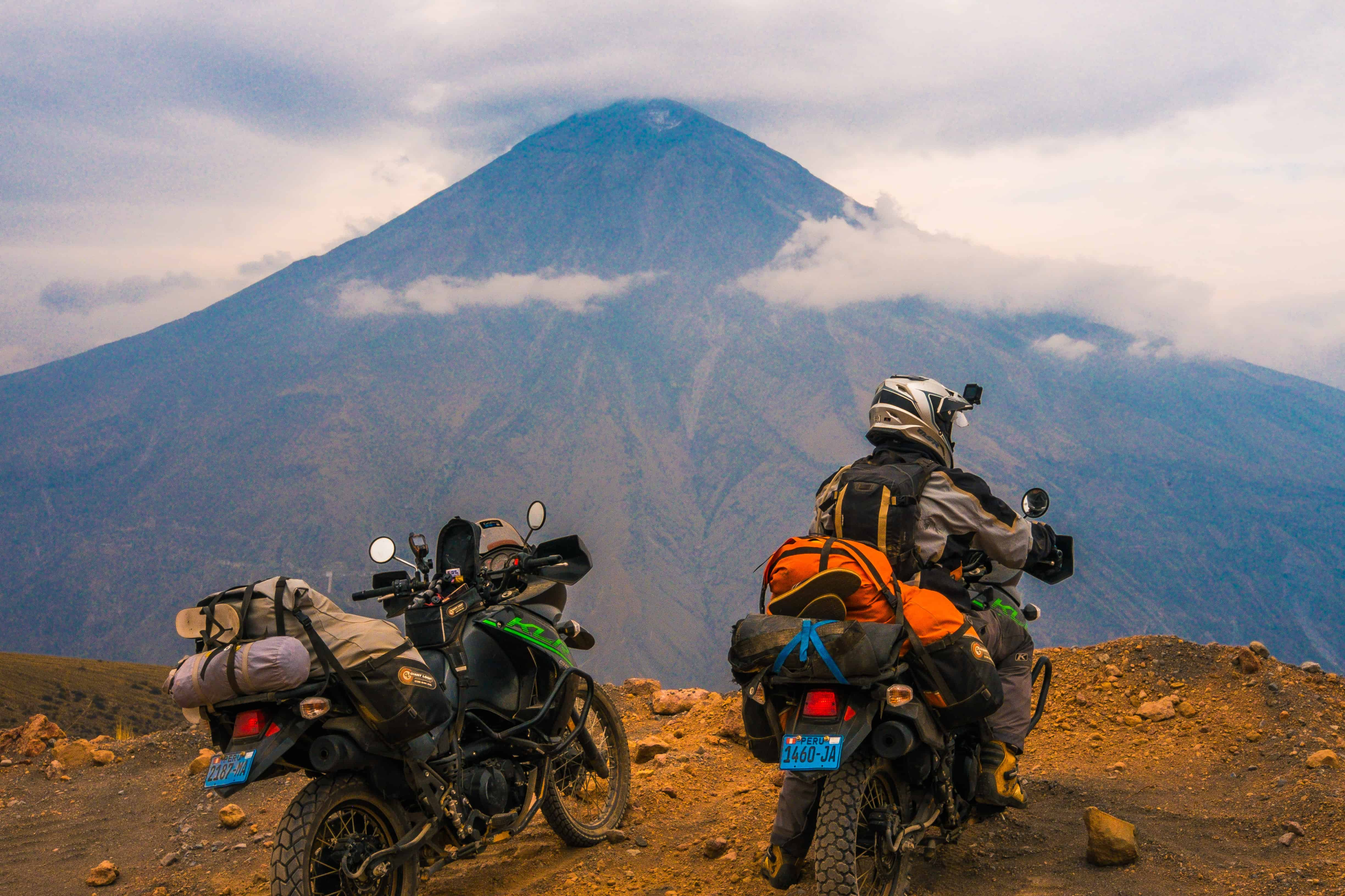 motorcycles next to a mountain in the andes