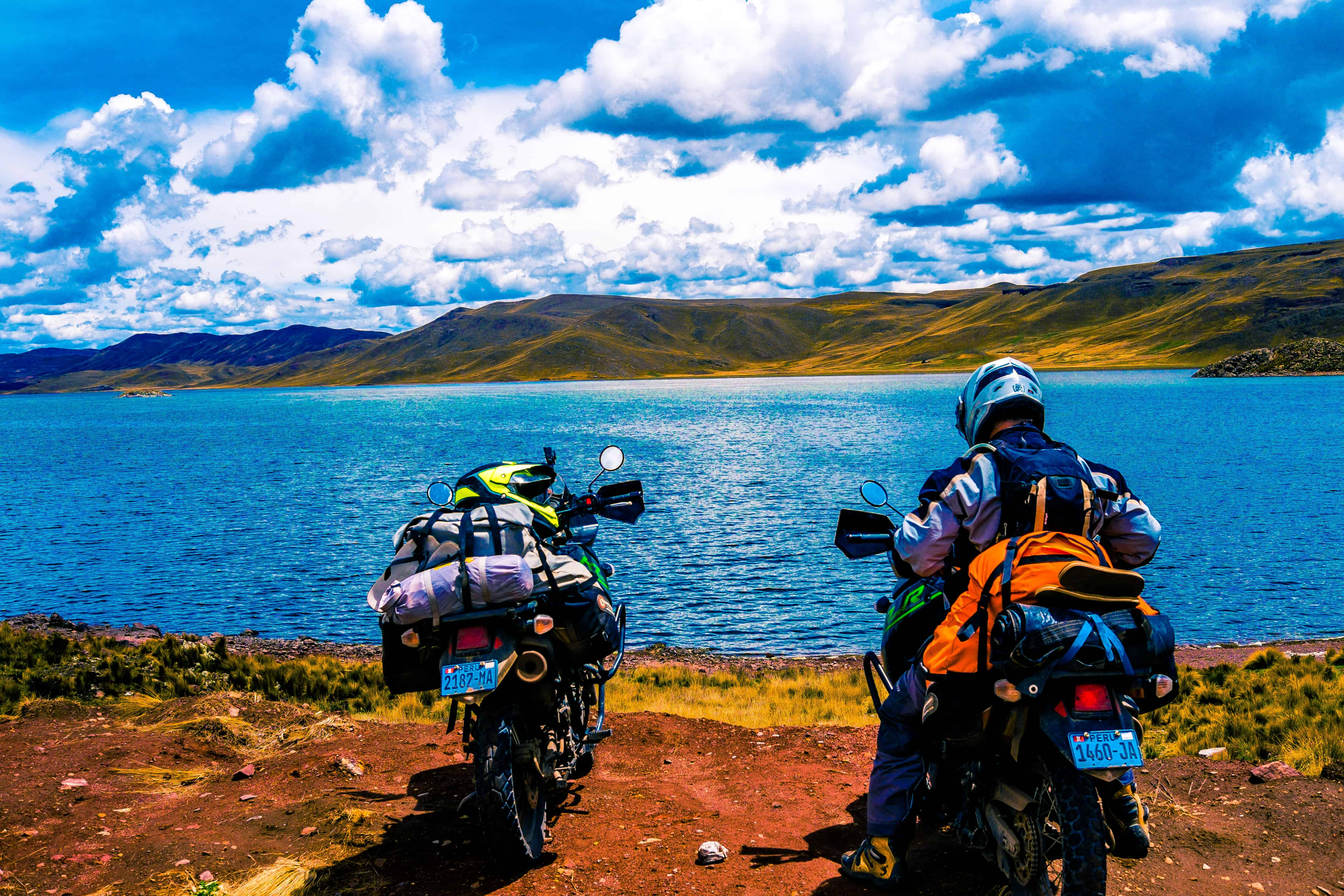 motorcycles at a lake in Peru for the 2019 dakar rally