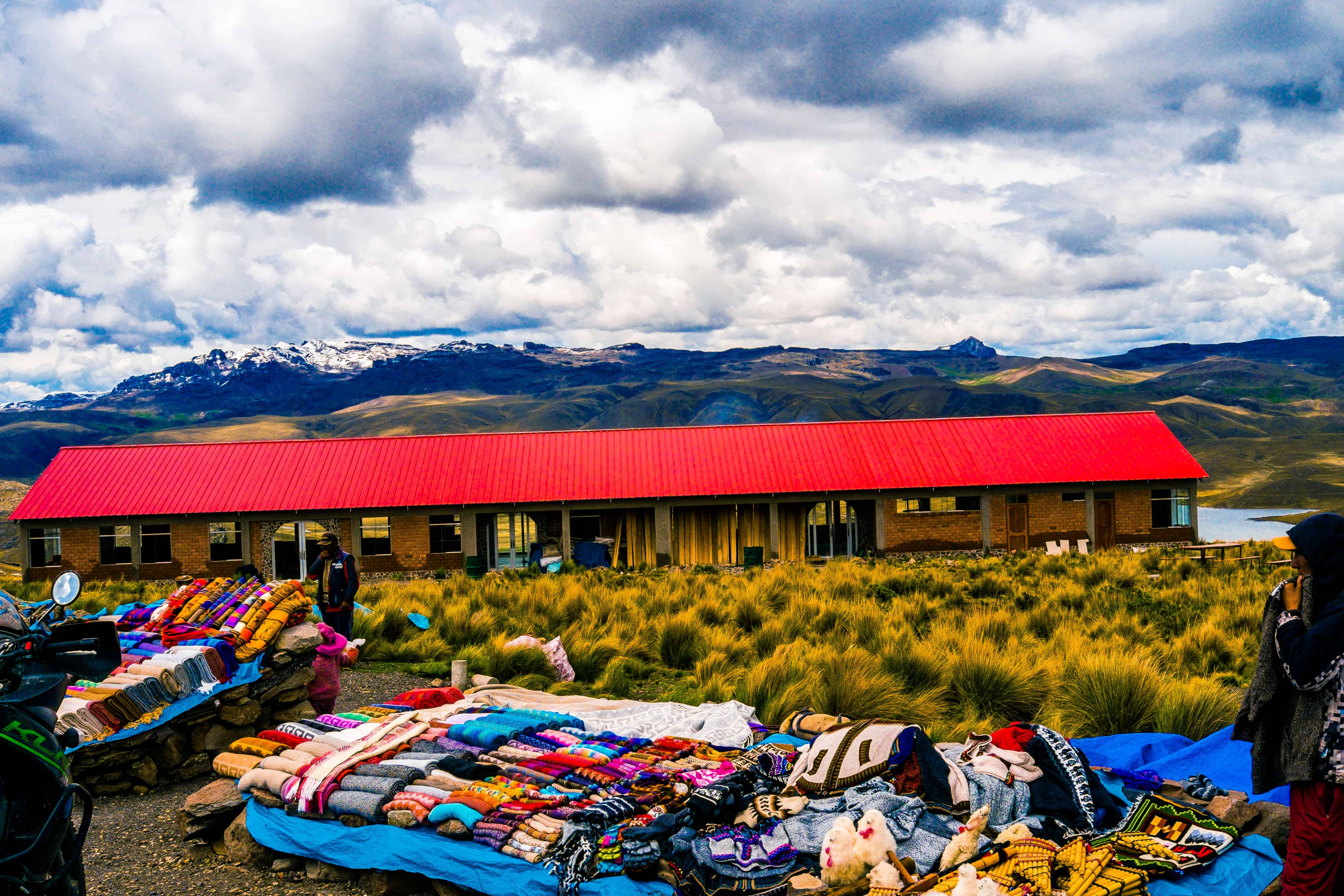 buying local fabrics in the andes mountains in peru while following the 2019 dakar rally